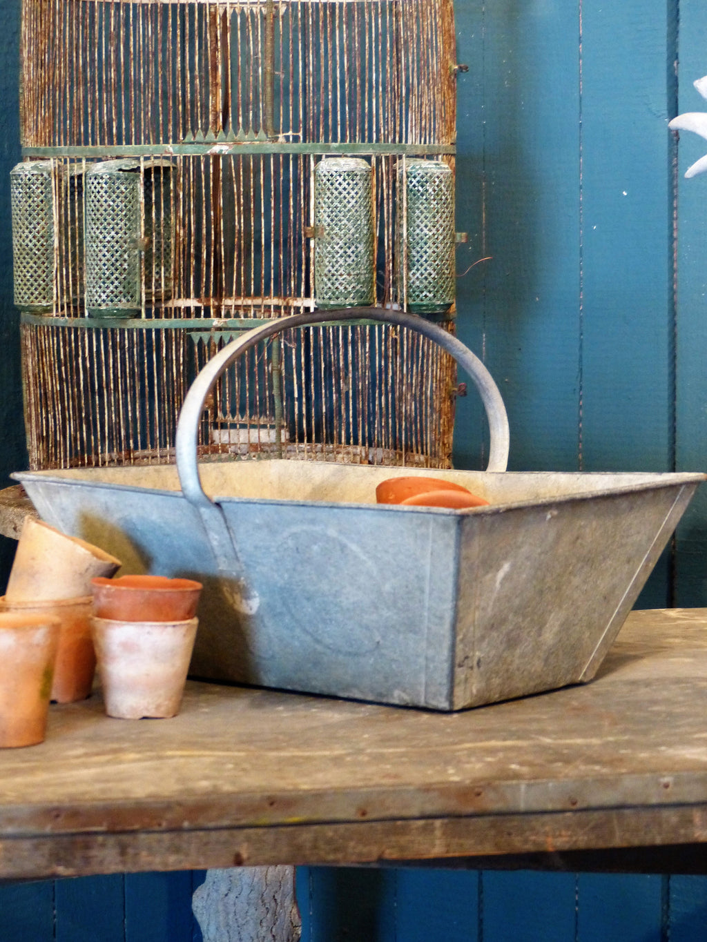 19th century French zinc basket with small vintage terracotta pots