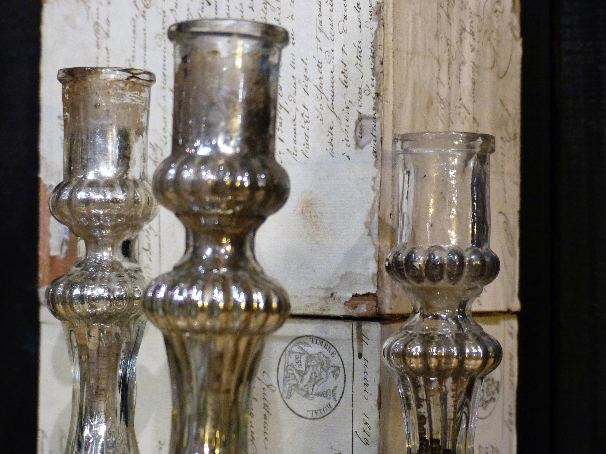 "Three 19th century French candlesticks from a church in ""l'argent de pauvre"""