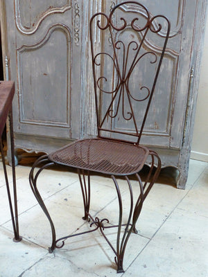 French garden setting four chairs