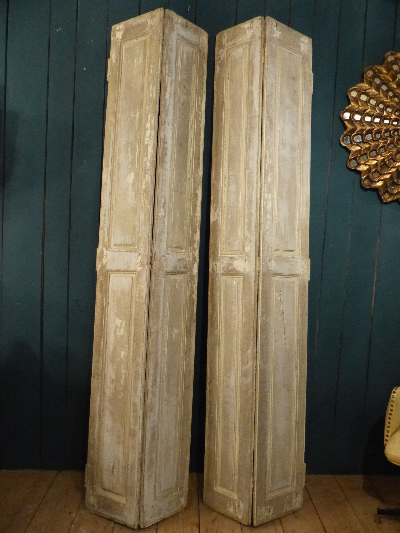 Pair of 19th century shutters with white patina