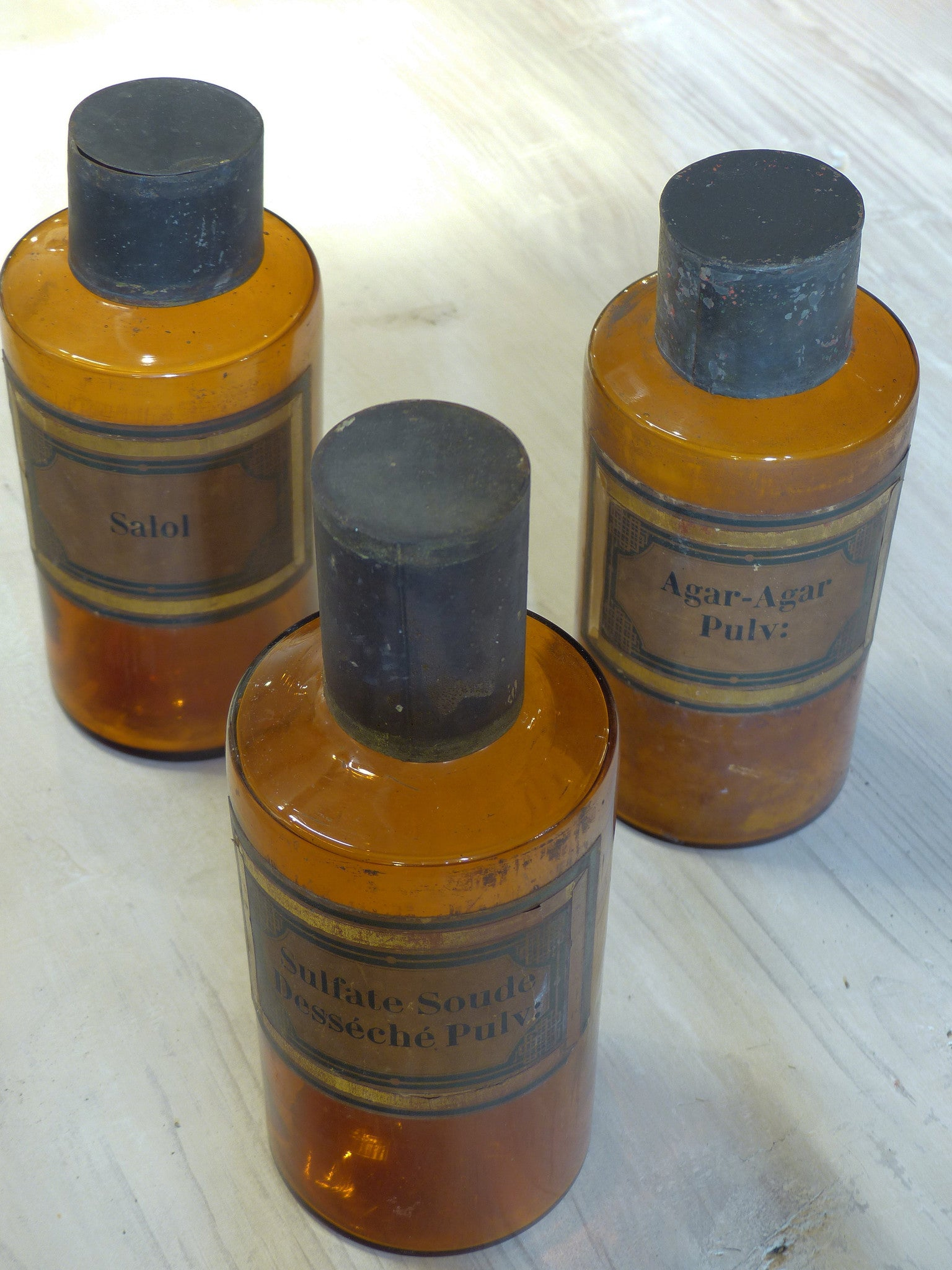 Set of three amber French Apothecary glass jars