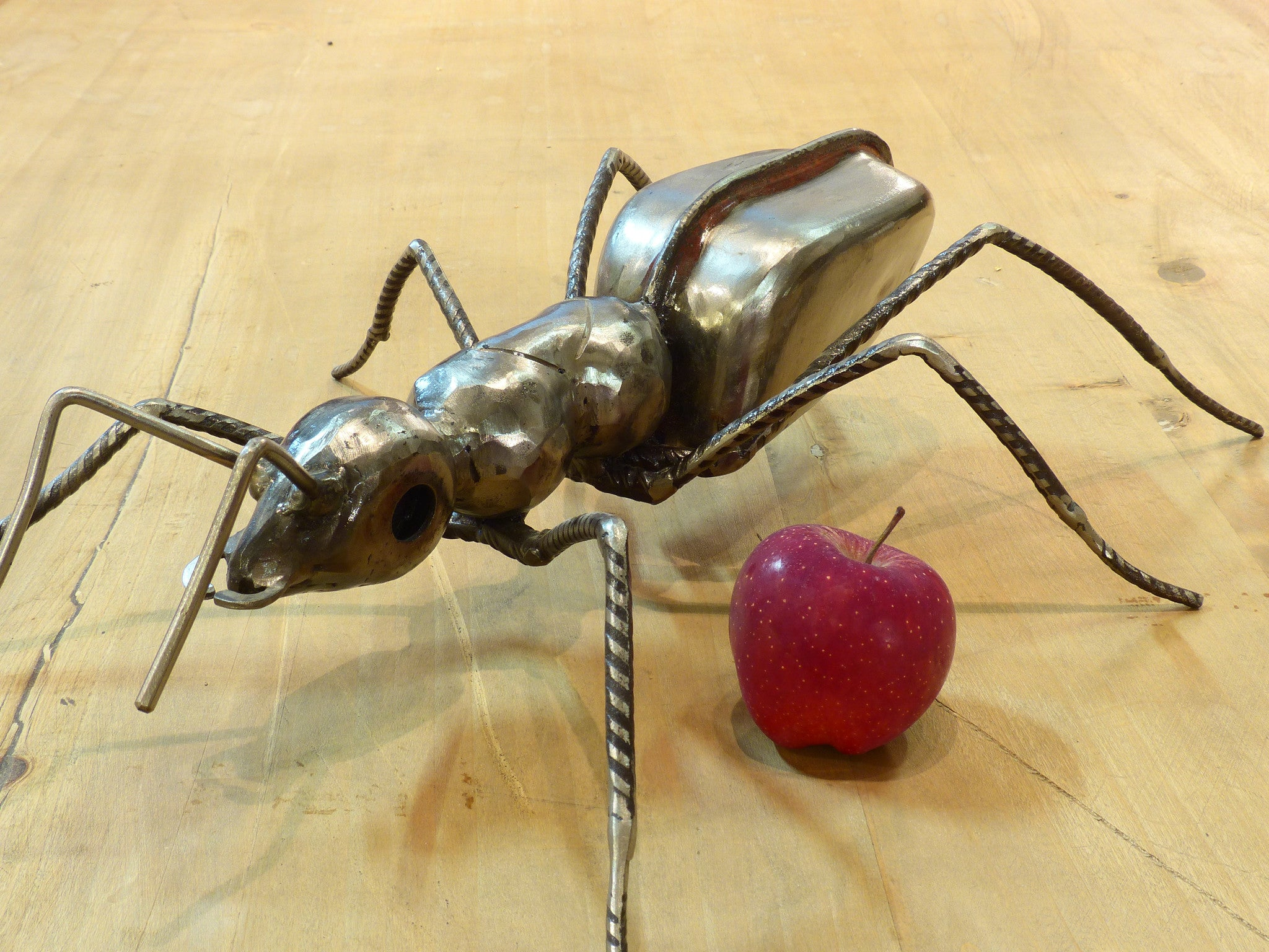 Sculpture of an ant from salvaged materials by Barral