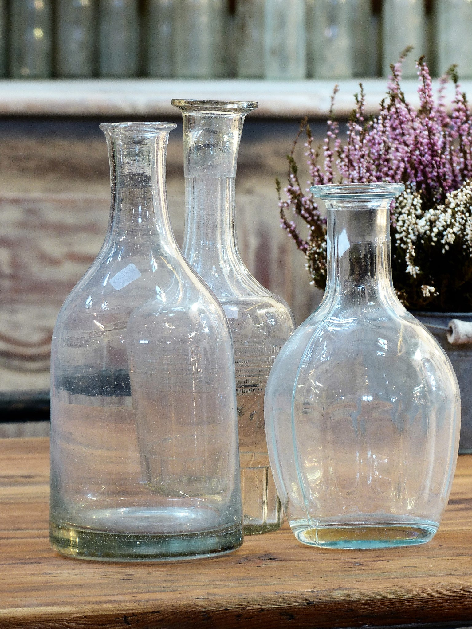 Set of three 19th and 20th century French glass bottles