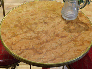 Round rose marble top bistro table with red stand
