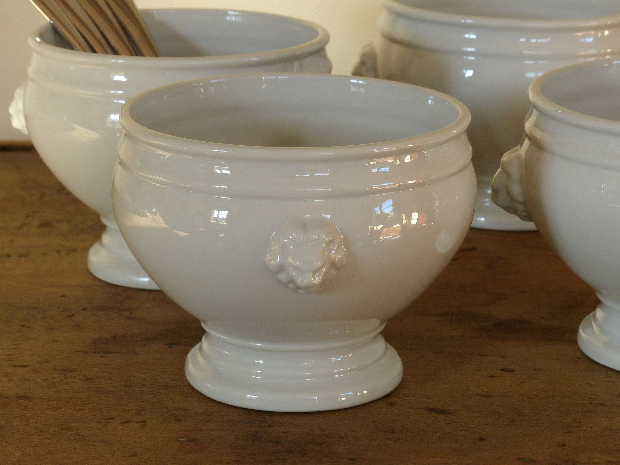 Set of four French lion head soup bowls