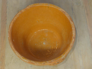 Rustic terracotta bowl with orange glaze