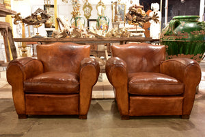Pair of large vintage French club chairs with mustache back