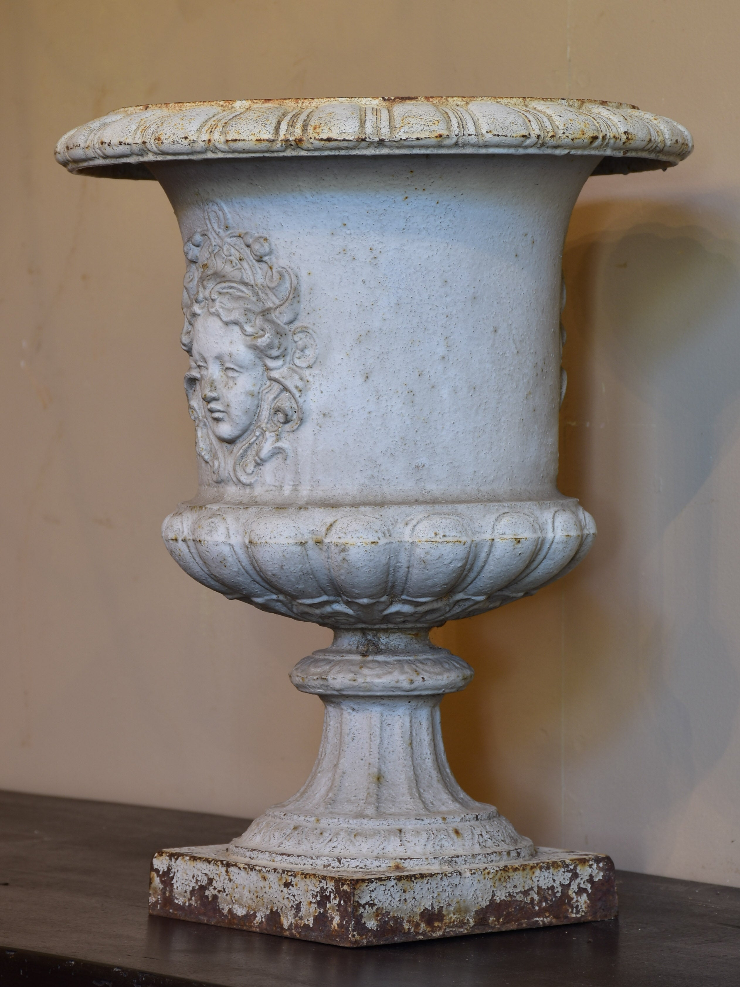 Antique French cast iron garden urn with angel faces