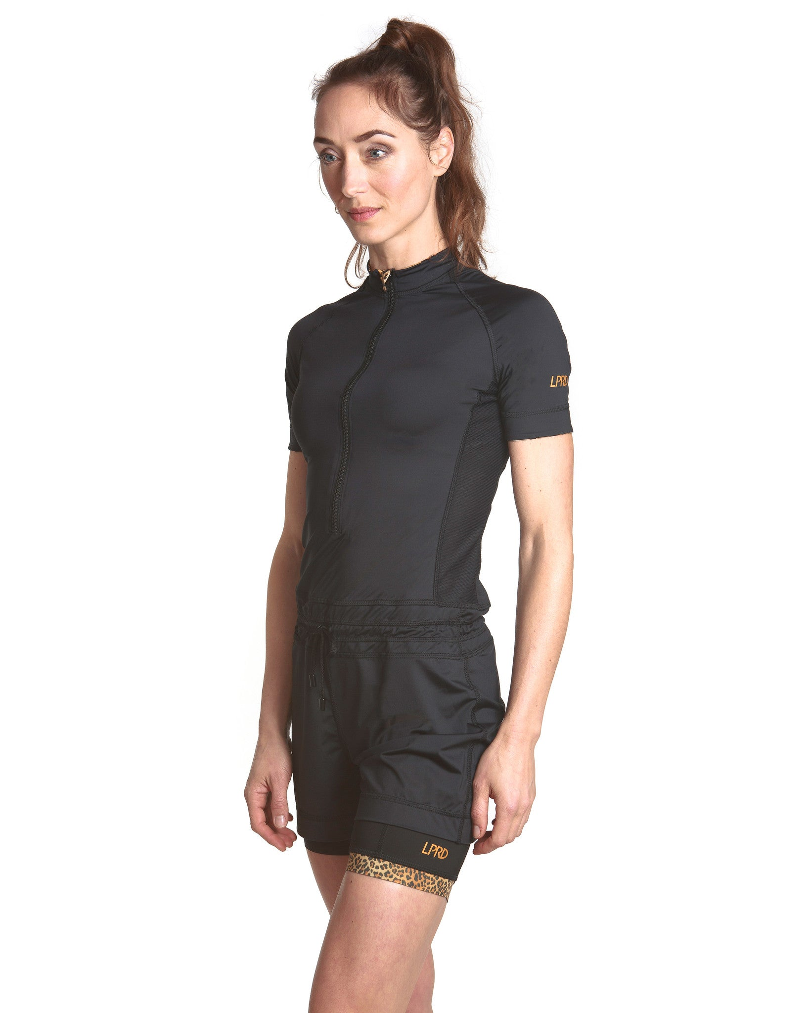 LPRD Black Onesie Jumpsuit | Close-up side view with black cycling shorts