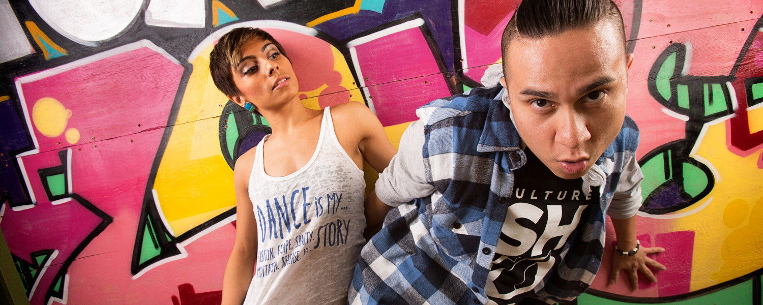 Culture Shock HipHop apparel photograph of two dancers with graffiti art in background