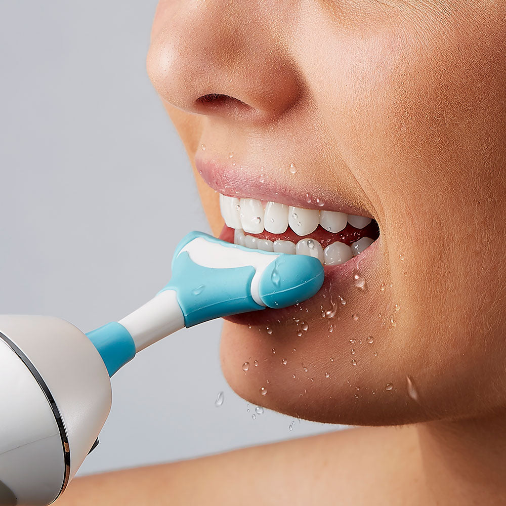 Water flossing with seven stream gum massager, blue in color.