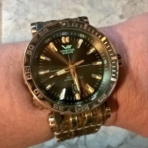 wrist shot of Vostok Europe Energia Bronze Tritium Dive Watch