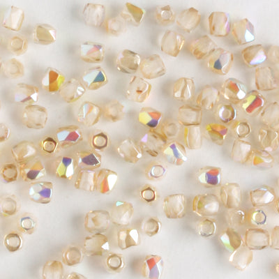 True 2mm Round Fire Polish Crystal Lemon Rainbow