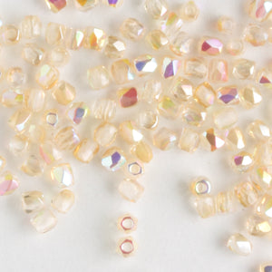 True 2mm Round Fire Polish Crystal Yellow Rainbow