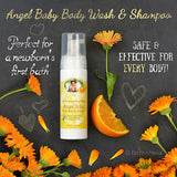 Natural Body Wash & Shampoo on gray background with oranges and flowers