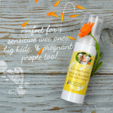 Non-Scented Natural Body Wash & Shampoo on wooden plank with orange flowers