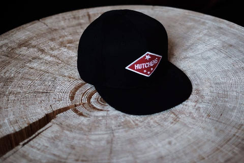 Hat with a diamond red logo