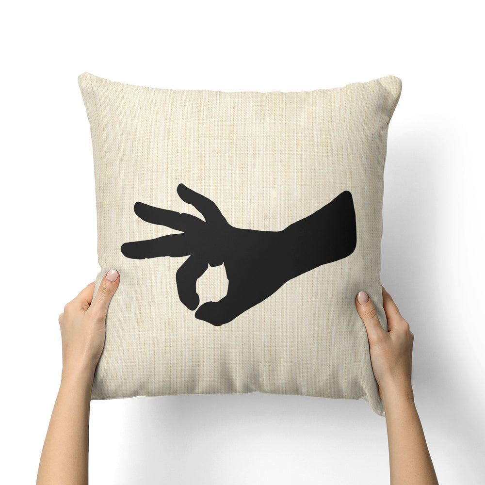 FINGER HOLE CANVAS PILLOW