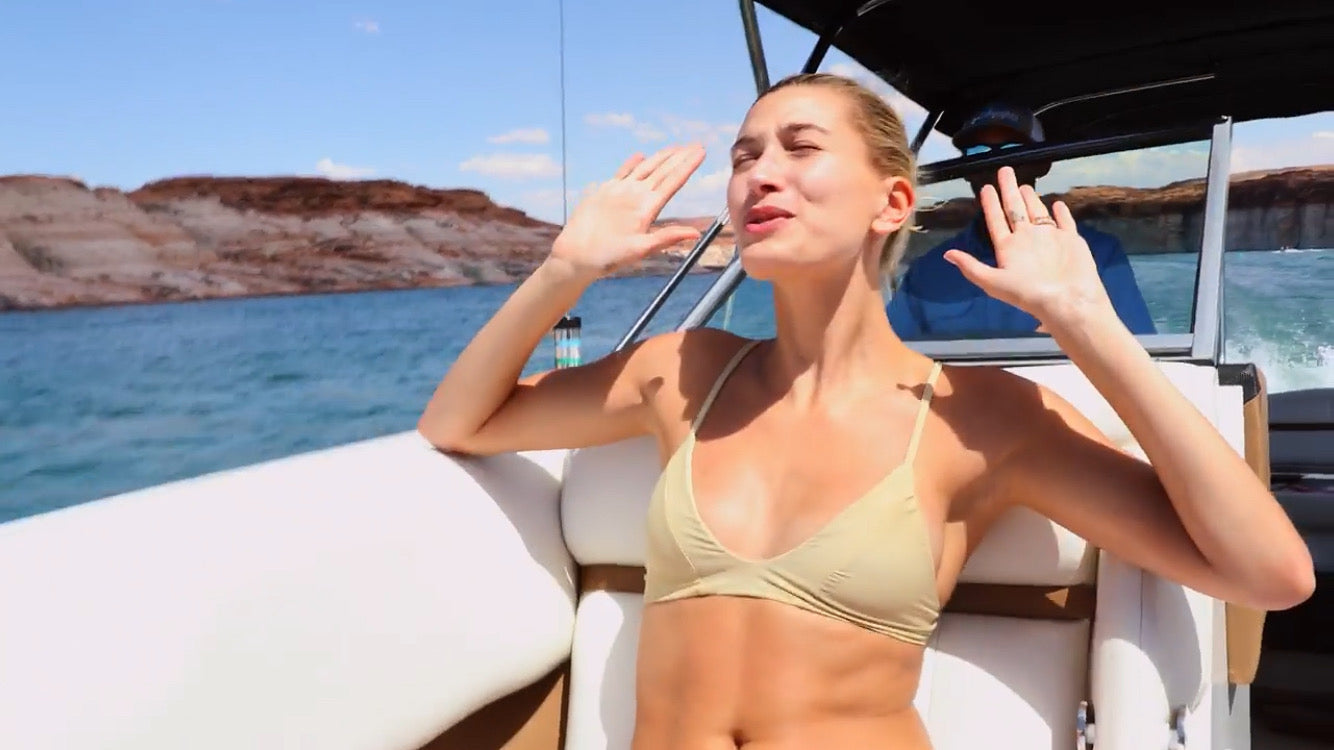 Hailey Bieber wears the iixiist Baby Bralette Bikini Top in Custard. Seamless Swim Nude Swim FrankiiSwim Frankie Swim Frankie Swimwear