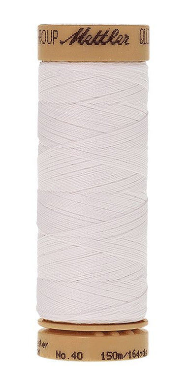 Mettler - waxed hand quilting thread in White