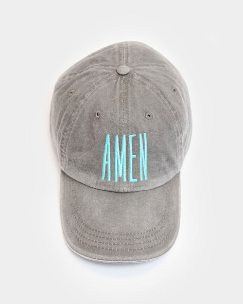 "This is a taupe unstructured hat with a teal embroidery design that says ""AMEN""."