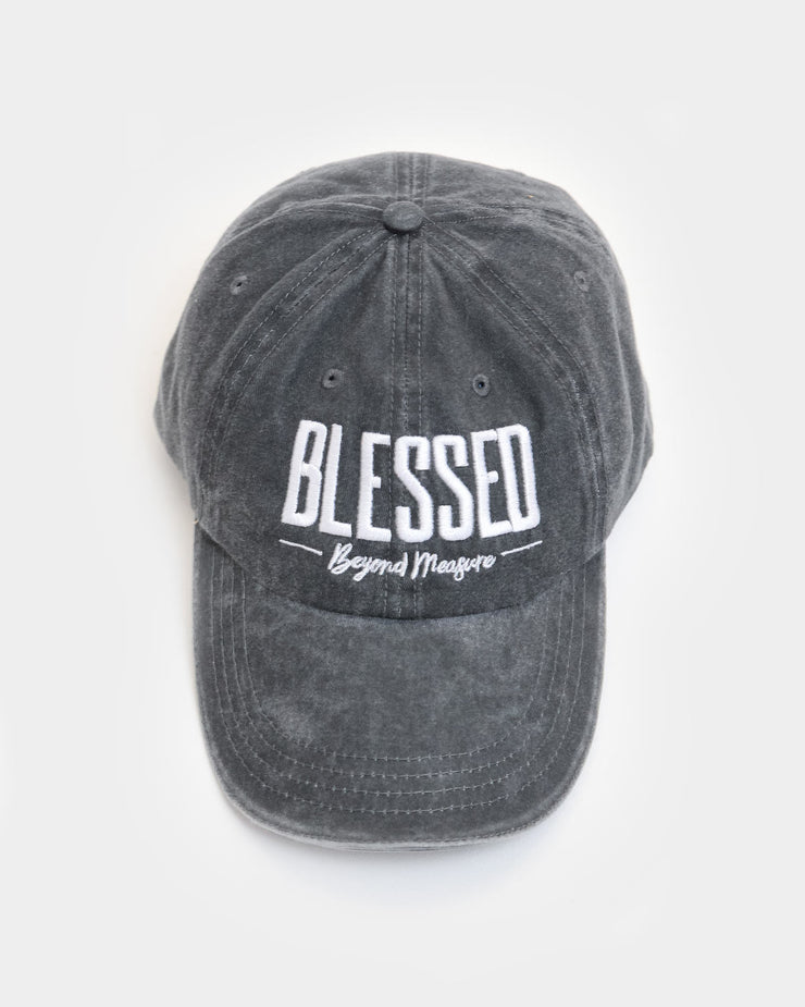 This is a coal hat with a blessed beyond measure design in white embroidery.