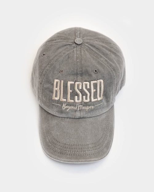 "This unstructured hat is taupe with tan embroidery with the ""Blessed Beyond Measure"" design."