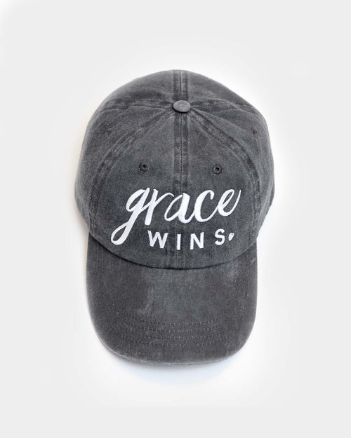 This is an unstructured coal hat with our grace wins design in white embroidery.