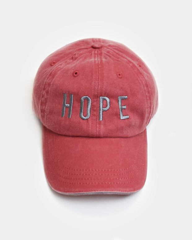 This is a brick red hat with our HOPE design in grey embroidery.