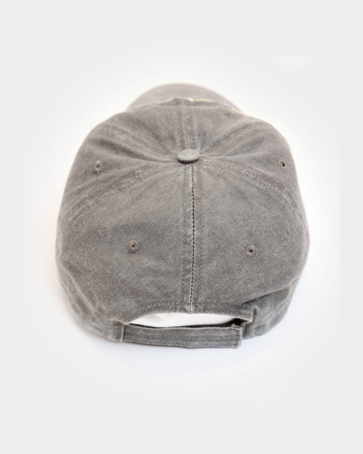 This unstructured hat is taupe with a velcro closure on the back.