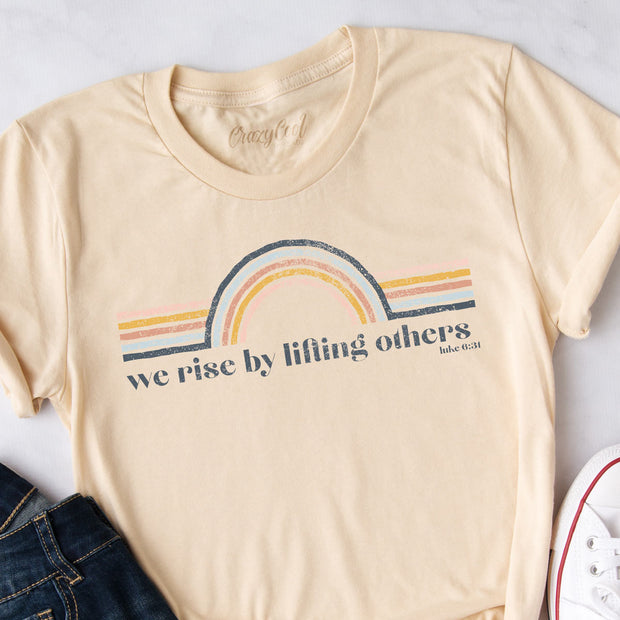 We Rise By Lifting Others (Rainbow) - Tee