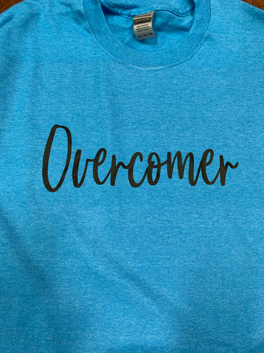 Overcomer.  $6 CLEARANCE TEES!  $8 For Long Sleeves!  Random Shirt Color Chosen.