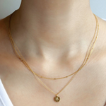 Double Layered Necklace with a Round Charm