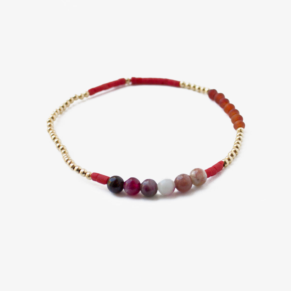 Curious Curious Bracelet with Gold Plated Beads and Red Gemstones
