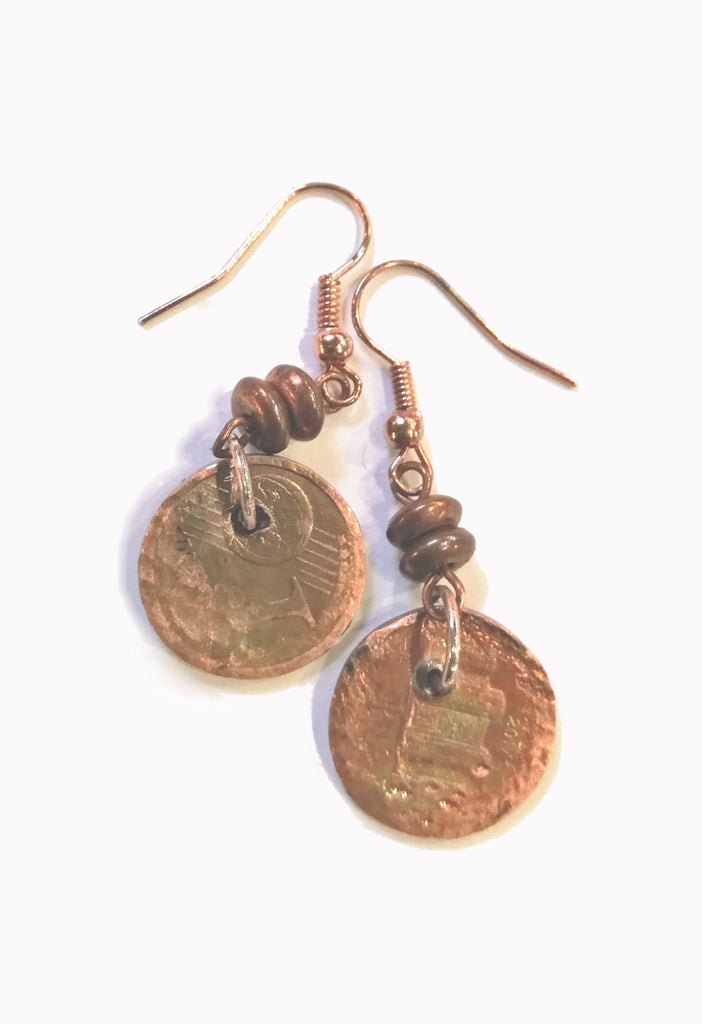 Heaven Cent Earrings. The earring are made fron European cent coins which have been hand hammered and oxidized to create a new patina
