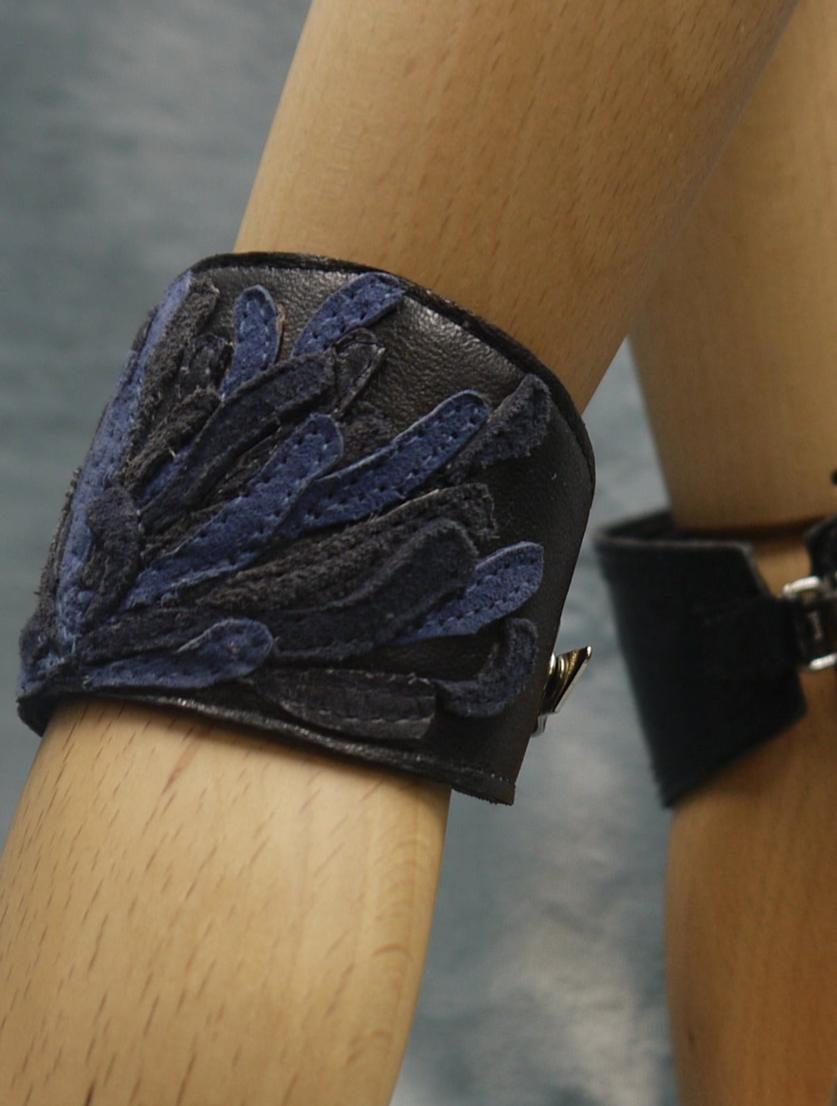 Chysanthemum Leather Cuff in black with dark blue and royal blue,hand cut petals, one-of-a- kind, unique, made in Italy by designer-makers