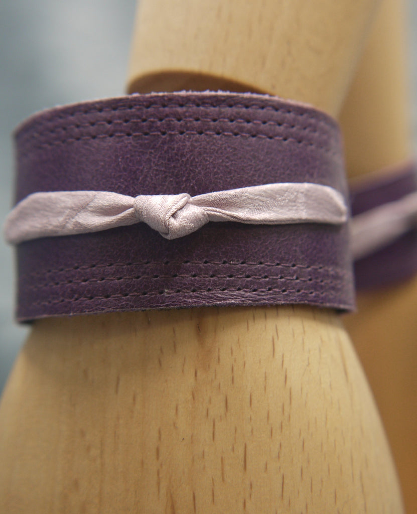 Royal Purple slimline Italian leather cuff with lilac slim silk knot central on the cuff. The cugff has elegant repeat stitch detail around the edges. Close-Up Image