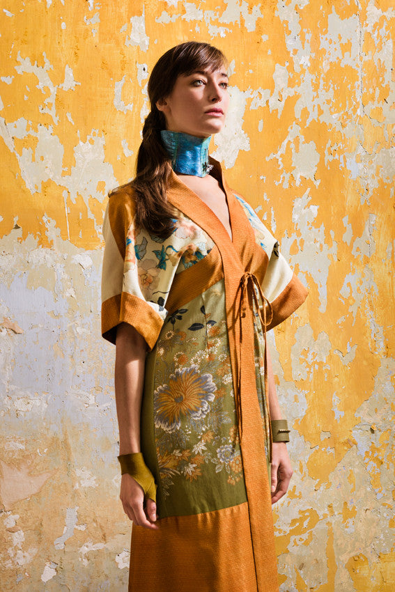 Model wears Kimono Shirt Dress in shaded olive green floral print and burnt orange silk