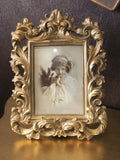 Antique Gold Ornate Picture Frame in place