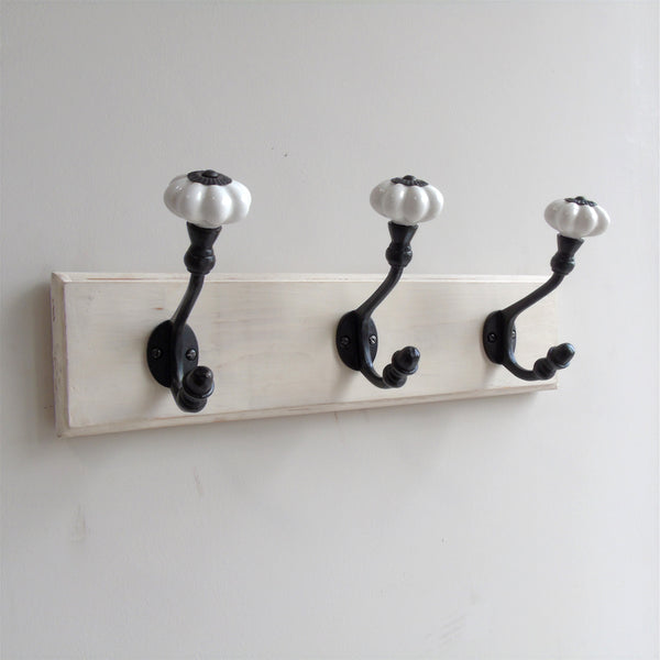 A Vintage White Painted Wooden Wall Door Storage Coat Rack  - Cast Iron Hook with Ceramic Hooks