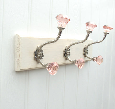 A Vintage Style Wooden Wall Storage Hook Rack with 3 Pink Glass Hooks