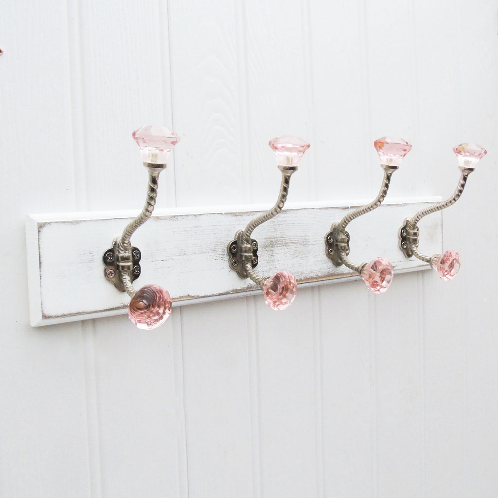 A Shabby Chic Wooden Coat Hook Rack with 4 Pink Glass Hooks