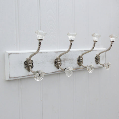 A Shabby Chic Wooden Coat Hook Rack with 4 Clear Glass Hooks