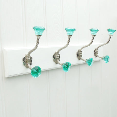 A Shabby Chic White Wooden Coat Hook Rack with 4 Green Glass Hooks