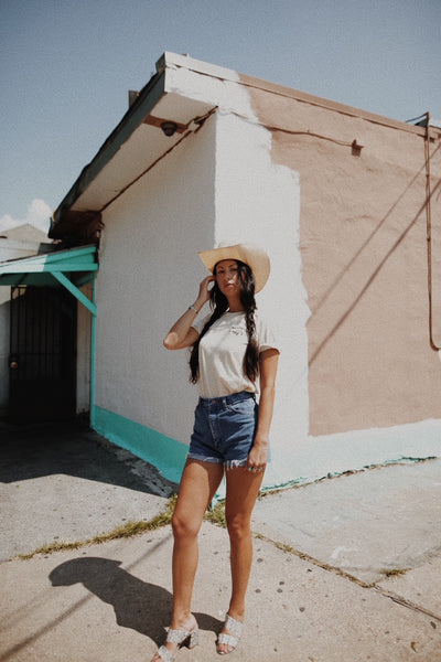 girl in cowboy hat and heels