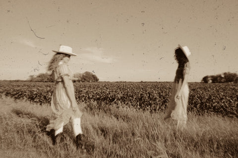 two girls standing in a field