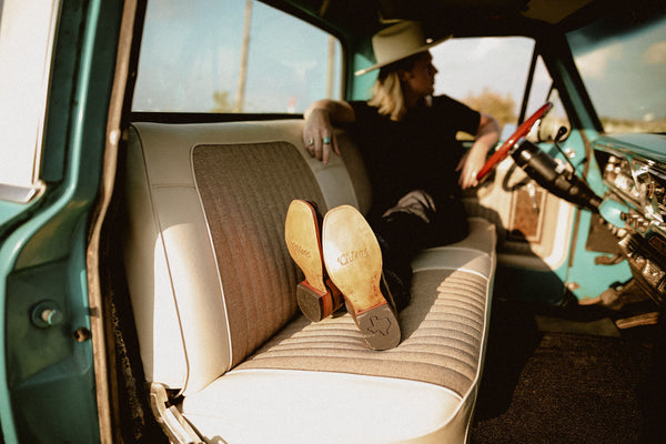 man in truck with boots