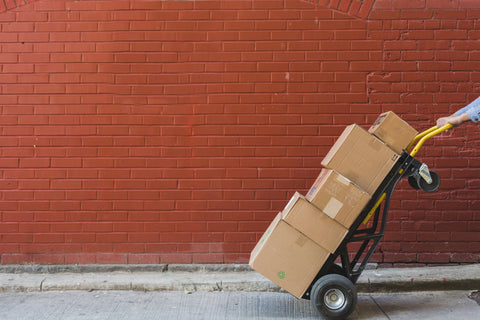 Shipping boxes in front of red brick wall