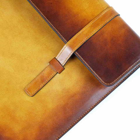This is Bonard our laptop computer case which is full leather with hand color patina made in Saigon -Dominique Saint Paul