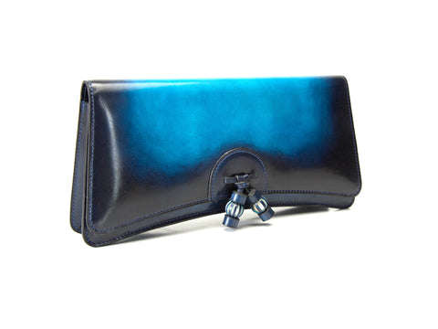 Léa clutch bag hand painted in a vibrant blue sunset patina